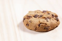 Oatmeal cookies with chocolate on a wooden background royalty free stock image