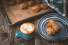 Oatmeal cookies and coffee cup on a wooden table Royalty Free Stock Photography