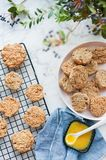 Oatmeal cookies cool on a grill on a marble table vertical Royalty Free Stock Image