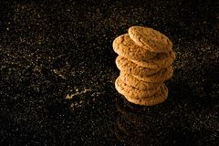 Oatmeal cookies with crumbs,  on a black background Stock Photography