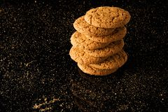 Oatmeal cookies with crumbs,  on a black background Royalty Free Stock Photo