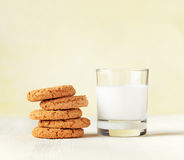Oatmeal cookies and cup of coffee on wooden table Stock Photos