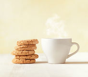 Oatmeal cookies and cup of coffee on wooden table Royalty Free Stock Photos