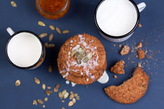Oatmeal cookies and cup of milk on dark blue concrete background. Stock Photo