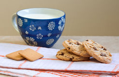 Oatmeal cookies, cup of milk, plain breakfast Stock Images