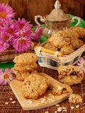 Oatmeal cookies and daisy flowers Royalty Free Stock Images