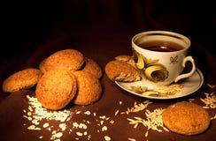 Oatmeal cookies dark. Oatmeal cookies on dark background stock photos