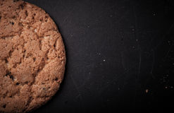 Oatmeal cookies on a dark background with place for text Stock Photos