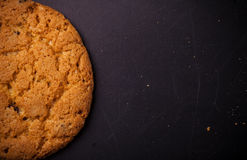 Oatmeal cookies on a dark background with place for text Royalty Free Stock Photography
