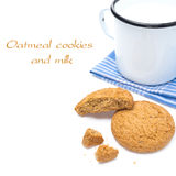 Oatmeal cookies and enamel mug of milk isolated on white Royalty Free Stock Photos