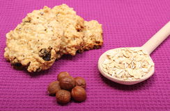 Oatmeal cookies with flakes and hazelnut on purple background Royalty Free Stock Images