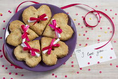 Oatmeal cookies in the form of heart with the letter. Idea for a breakfast to darling Stock Images