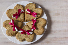 Oatmeal cookies in the form of heart with letter and ribbon. Gift for St. Valentine's Day Stock Photo