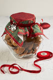 Oatmeal cookies in glass jar and christmas decoration Royalty Free Stock Images