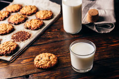 Oatmeal Cookies and Glass of Milk. Homemade Oatmeal Cookies with Raisins and Glass of Milk for Breakfast. Some Cookies on Parchment Paper with Bottle on Royalty Free Stock Image