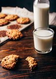 Oatmeal Cookies and Glass of Milk. Oatmeal Cookies with Raisins and Glass of Milk for Breakfast. Some Cookies on Parchment Paper with Bottle on Backdrop stock photography