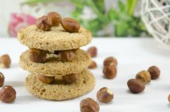 Oatmeal cookies and hazelnuts Royalty Free Stock Photography