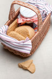 Oatmeal cookies and jam in a basket Royalty Free Stock Photos