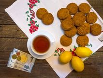 Oatmeal cookies and lemons are bought to tea Royalty Free Stock Images