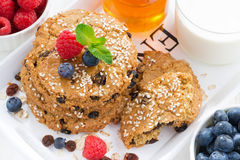 Oatmeal cookies, milk and berries for a healthy breakfast Royalty Free Stock Image