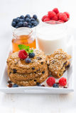 oatmeal cookies, milk and berries for a healthy breakfast Stock Photos