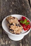 Oatmeal cookies with milk and fresh berries, vertical, close up Stock Photos