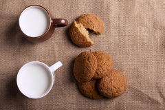 Oatmeal cookies and milk Stock Images