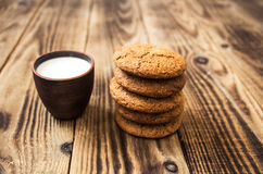 Oatmeal cookies with milk on a wooden background Stock Image