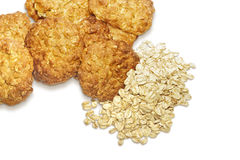 Oatmeal cookies and oat-flakes isolated on white Royalty Free Stock Image