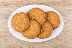 Oatmeal cookies in oval dish on wooden table Stock Image