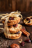 Oatmeal cookies with pecan nuts, cranberries and honey. Homemade whole wheat oatmeal cookies with pecan nuts, dried cranberries and honey Stock Image