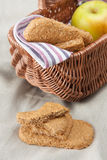 Oatmeal cookies and a picnic basket Royalty Free Stock Photos