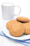 Oatmeal cookies on a plate and cup of milk Royalty Free Stock Photography