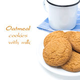 Oatmeal cookies on the plate and mug of milk isolated, close-up Stock Photo