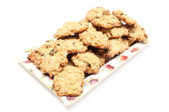 Oatmeal cookies with raisins on colorful plate Stock Photography