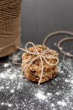 Oatmeal cookies with raisins. And flour on wooden table Royalty Free Stock Image