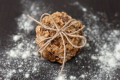Oatmeal cookies with raisins. And flour on wooden table Royalty Free Stock Photography