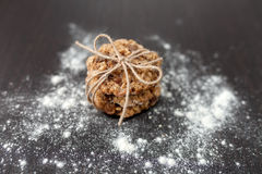 Oatmeal cookies with raisins. And flour on wooden table Stock Photography