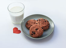 Oatmeal cookies with raisins a glass of milk royalty free stock photo