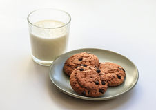 Oatmeal cookies with raisins a glass of milk stock photo