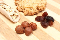 Oatmeal cookies with raisins and hazelnut on wooden background Royalty Free Stock Photo