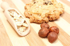 Oatmeal cookies with raisins and hazelnut on wooden background Stock Photo
