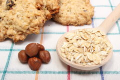 Oatmeal cookies with raisins and hazelnut on wooden background Royalty Free Stock Photos