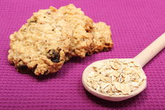 Oatmeal cookies with raisins and hazelnut on wooden background Royalty Free Stock Image