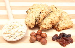 Oatmeal cookies with raisins and hazelnut on wooden background Stock Images