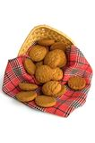 Oatmeal cookies with a red cloth. Oatmeal cookies on a red checkered napkin in a wicker basket with a light shade on white background stock images