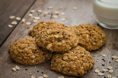 Oatmeal cookies with sesame seeds and glass of milk Stock Images