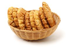 Oatmeal cookies with sesame seeds. On white background royalty free stock photography