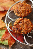 Oatmeal cookies  on a table covered with autumn lea Stock Photos