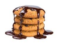 Oatmeal cookies, watered liquid chocolate Stock Image
